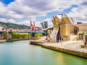 The cityscape of Bilbao, Spain. The Nervion river crosses Bilbao downtown, hosting in its margins the traditional and modern buildings of the city.